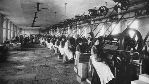 The can-making room at Cleeve Bros, condensed milk factory, Limerick. It is part of the  Working Lives 1893-1913 exhibition at the National Photographic Archive. Photograph : National Library of Ireland.