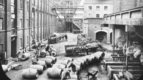 Barrels at Dunville whiskey distillery, Belfast. It is part of the  exhibition which contains 148 photographs of workers throughout Ireland. Photograph: National Library of Ireland