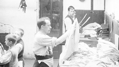 A man looks at a shirt at Smyth and Co Trimming shop, Balbriggan. Photograph: National Library of Ireland