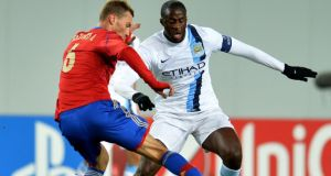 Aleksei Berezutski (left) of PFC CSKA Moscow in action against Yaya Toure of Manchester City  during the UEFA Champions League Group D match at the Arena Khimki Stadium. Photograph:  Epsilon/Getty Images.