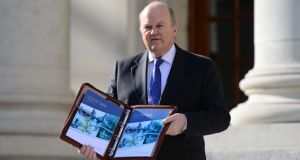Minister for Finance  Michael Noonan at Government Buildings before delivering the Budget to the House. Photograph: Bryan O'Brien /The Irish Times.