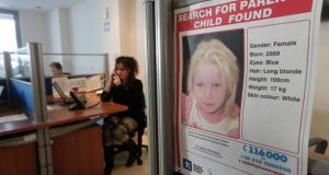 "A poster of  four-year-old girl ""Maria"", who was found living with a couple in a Roma camp in central Greece, in the office of the Smile of the Child charity in Athens. Photograph: John Kolesidis/Reuters"