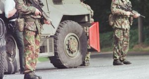 File shot of British army personnel on patrol in Northern Ireland.   The 1994 murder of Roseanne Mallon is a source of major controversy, with claims of security force collusion. In the wake of the shooting, British army surveillance equipment, including a hidden camera, was found in a field overlooking the house. Photograph: Ian Waldie/Reuters