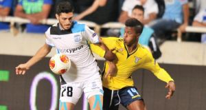 Apollon Limassol's Marios Stylianou (left) is challenged by Lazio's Keita Balde  in Nicosia. Photograph: Andreas Manolis/Reuters
