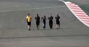 Red Bull Formula One driver Sebastian Vettel (centre) of Germany walks  the track at the Buddh International Circuit in Greater Noida on the outskirts of Delhi. Photograph: Adnan Abidi/Reuters