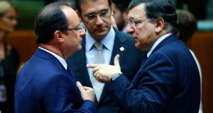 France's president Francois Hollande (left) talks with Portugal's prime minister Pedro Passos Coelho (centre) and European Commission president José Manuel Barroso during a European Union leaders summit in Brussels last night. Photograph: Yves Herman/Reuters