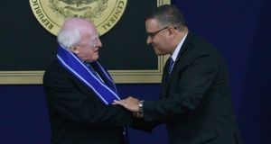 President Michael D Higgins shakes hands with El Salvador's president Mauricio Funes after being honoured with the Jose Matias Delgado state award at the presidential house in San Salvador yesterday. Photograph: Ulises Rodriguez/Reuters