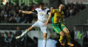 SWANSEA, WALES - OCTOBER 24: Swansea player Michu (c) beats Aleksei Kozlov (r) to the ball during the UEFA Europa League Group A match between Swansea City and FC Kuban Krasnodar at Liberty Stadium on October 24, 2013 in Swansea, Wales. (Photo by Stu Forster/Getty Images)