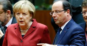 Chancellor Angela Merkel and President Francois Hollande: spying revelations  cast a shadow over the EU summit in Brussels yesterday. Photograph: Yves Herman