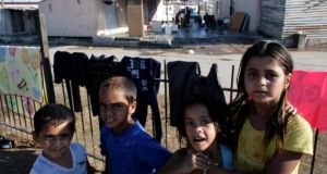 Children from a Roma community pose for photos at a Roma settlement north of the Greek capital  Athens. Photograph: Milos Bicanski/Getty Images