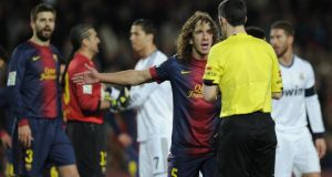 Barcelona captain Carles Puyol  argues with  referee Alberto Undiano Mallenco during the heated Spanish Cup semi-final second leg against Real Madrid   at the Camp Nou in  February. Photograph:  Lluis Gene/AFP/Getty Images)