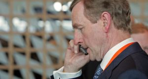 The Taoiseach on the phone at his party's Ard Fheis. Photograph: Eric Luke
