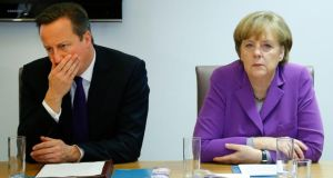 British prime minister David Cameron and German chancellor Angela Merkel ata meeting on the sidelines of an EU summit in Brussels yesterday. Migration and an upcoming Eastern Partnership summit  topped the summit agenda. Photograph: Yves Herman/AP