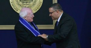 IPresident Michael D Higgins  shakes hands with El Salvador's president Mauricio Funes after being honoured with the Jose Matias Delgado state award at the presidential house in San Salvador  earlier this week. Photograph: Ulises Rodriguez/Reuters