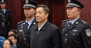 Bo Xilai  stands as the decision of his appeal is announced at the Shandong Higher People's Court in Jinan. Photograph: Reuters.