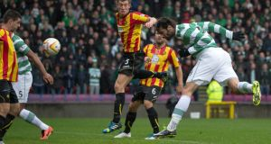 Celtic's Georgios Samaras heads home the opener against Partick Thistle.