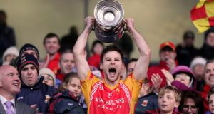 Castlebar's captain Donal Newcombe lifts the Moclair Cup. Photograph: James Crombie/Inpho