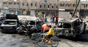 Site of a car bomb in Baghdad's al-Shaab district yesterday. Ten car bombs exploded in the province, killing 42 people. Photograph: Reuters/Thaier al-Sudani