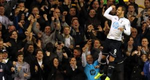 Tottenham's Roberto Soldado celebrates after scoring the controversial spot kick.