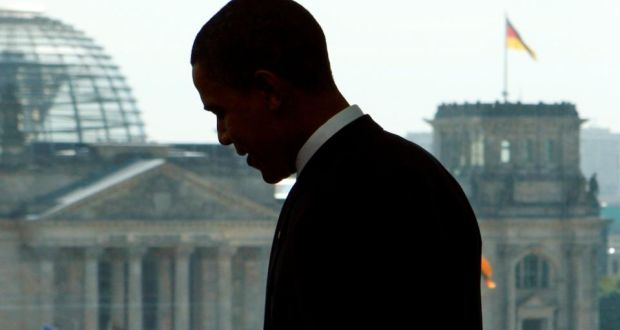 Barack Obama  standing in front of a window with a view of the  Reichstag during a meeting with German Chancellor Angela Merkel in Berlin in  2008. Photograph: Reuters.