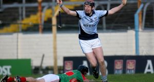 Na Piarsaigh's David Dempsey celebrates scoring his side's third goal of the game against Loughmore-Castleiney. Photograph: Inpho