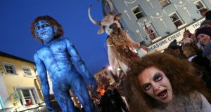 Macnas performers  draw a huge crowd on to the streets of Galway city during their On the Night Journey parade  yesterday evening. Photograph: Joe O'Shaughnessy
