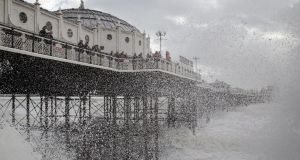 Waves crash near Brighton Pier in East Sussex. Photograph: Gareth Fuller/PA Wire