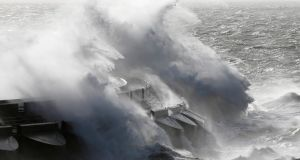 Waves batter into the sea wall of a marina in Brighton, south England