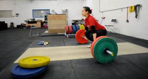 Alex Craig weightlifting at her club in Dolphin's Barn. Photograph: Dave Meehan