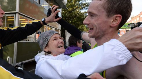 Sean Hehir is congratulated by his mother  Cushla Murphy at the finish line.Photograph: Cyril Byrne/The Irish Times