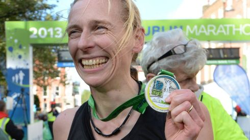 Maria Mc Cambridge shows off her medal. Photograph: Cyril Byrne/The Irish Times