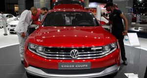 Visitors look at Volkswagen's Cross Coupe during  a recent  media preview of the Johannesburg International Motor Show. Photograph: Siphiwe Sibeko/Reuters