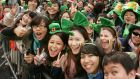 There are more Chinese tourists than ever, including those seen at the St Patrick's Day parade in Dublin last year. Photograph: Alan Betson/The Irish Times