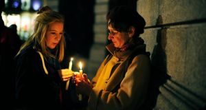 Hope Calloway and Carol Thompson at the vigil held in honour of Savita Halappanavar in Dublin yesterday evening. Photograph: Aidan Crawley