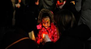 Hanna Counitre (3) from Dublin at a candlelight vigil held in honour of Savita Halappanavar in Dublin city yesterday evening.Photograph: Aidan Crawley