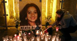 Candles are lit by the public at the vigil at Eyre Square in Galway city last evening to mark the first anniversary of the death of Savita Halappanavar. Photograph: Joe O'Shaughnessy.