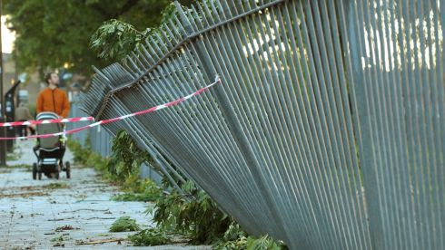 A fence is seen after being crushed by a falling branch beside Ruskin Park, Camberwell, London: Anthony Devlin/PA Wire