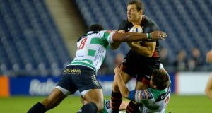 Edinburgh's Tim Visser is tackled by Treviso's Manoa Vosawai last weekend. Photograph: Russell Cheyne/Inpho
