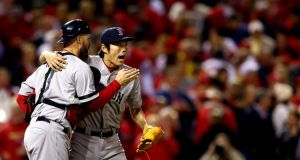 Koji Uehara (right) celebrates with David Ross after the Boston Red Sox defeated the St Louis Cardinals in Game 5 of the World Series. Photograph: Elsa/Getty Images