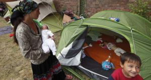 A Roma family after their eviction from an encampment in Villeneuve d'Ascq in France last year. Photograph: Reuters