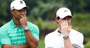 Tiger Woods and  Rory McIlroy at the Blackstone Course, Mission Hills, China,  on Monday.  Photograph:  Lintao Zhang/Getty Images