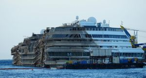 The severely damaged side of the stricken Costa Concordia is visible after the parbuckling salvage operation successfully uprighted the ship  on September 17th in Isola del Giglio, Italy. Photograph: Marco Secchi/Getty Images.