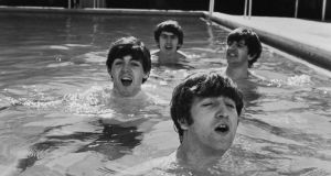 (L-R) Paul McCartney, George Harrison, John Lennon & Ringo Starr of the Beatles, taking a dip in a swimming pool . (Photo by John Loengard//Time Life Pictures/Getty Images)