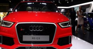 Visitors walk near the Audi RS Q3 during the media preview of the Johannesburg International Motor Show. Photograph: Reuters