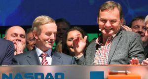Bruce Aust, executive vice-president of the global corporate client group at Nasdaq OMX, pictured with Taoiseach Enda Kenny at the Dublin Web Summit yesterday. Photograph: Colin Keegan/Collins Dublin