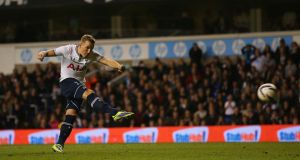 Harry Kane of Tottenham scores during the penalty shoot out during the Capital One Cup Fourth Round match between Tottenham Hotspur and Hull City at White Hart Lane on October 30, 2013 in London, England. Photograph: Clive Rose