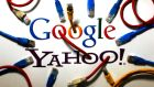 An illustration picture shows the logos of Google and Yahoo connected with LAN cables. Photograph: Pawel Kopczynski/Reuters