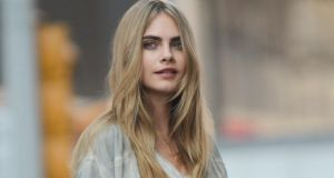 Model Cara Delevingne: Delevingne's psoriasis flared up during London Fashion week, when covered in scabs she had to be painted with make-up for the catwalk. Photograph: Ray Tamarra/Getty Images