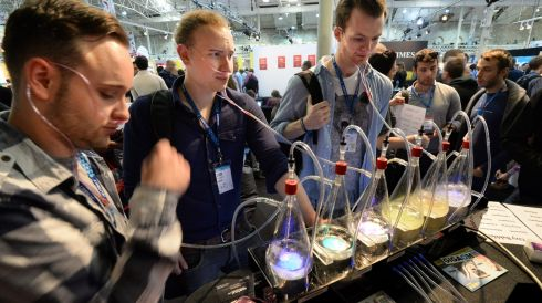 From left; Conor McKernan, Cian Gallagher and Sean Bourke McKenna, enjoy some Oxy Bubbles on the Squarespace stand. Photographer: Dara Mac Donaill / THE IRISH TIMES