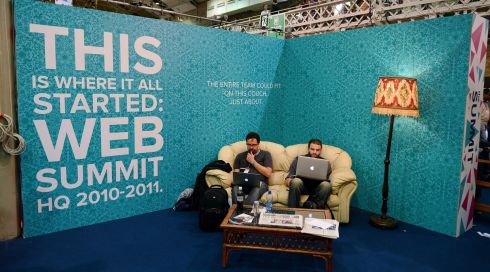 The couch effect: visitors take advantage of a tribute to the fact where the Web Summit all began in a student sitting room. Photograph: Aidan Crawley/Bloomberg